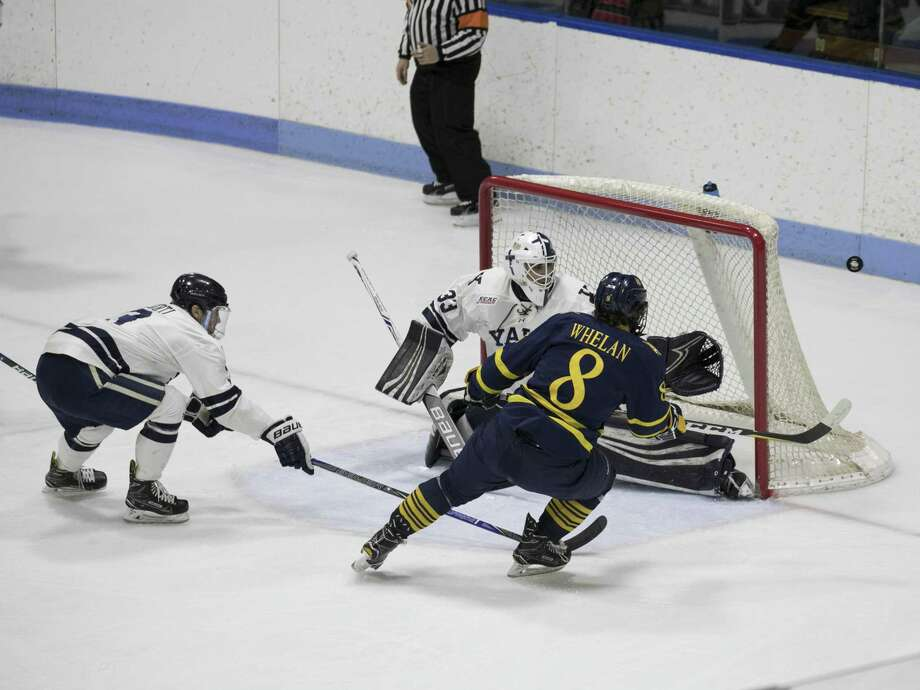 Quinnipiac's Alex Whalen watches his shot ricochet off the right post during the first period at Ingalls Rink on Saturday. Photo: Steve Musco / Yale Athletics