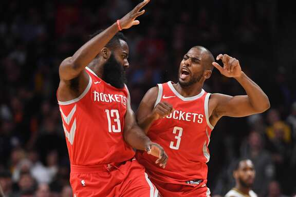 DENVER, CO - FEBRUARY 25: James Harden #13 and Chris Paul #3 of the Houston Rockets celebrate during a timeout against the Denver Nuggets at Pepsi Center on February 25, 2018 in Denver, Colorado. NOTE TO USER: User expressly acknowledges and agrees that, by downloading and or using this photograph, User is consenting to the terms and conditions of the Getty Images License Agreement. (Photo by Justin Tafoya/Getty Images)