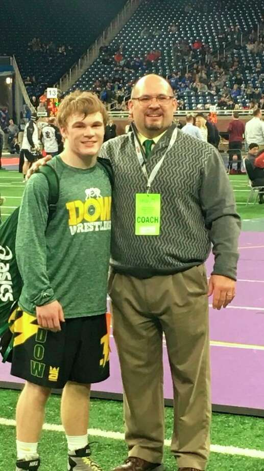 Dow High wrestler Brennan Doyle, left, is shown with his coach and father, Dennis Doyle, after earning All-State honors with a fifth place at the Division 1 state finals on Saturday.