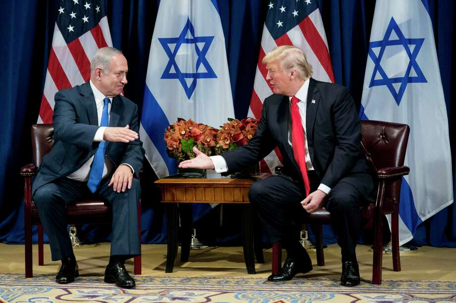 FILE -- President Donald Trump meets with Prime Minister Benjamin Netanyahu of Israel, in New York, Sept. 18, 2017. While White House officials have insisted that the recommendation of bribery and fraud charges against Netanyahu would not impact a peace plan, Trump has not rallied publicly to the Israeli leaderOs defense. (Doug Mills/The New York Times) Photo: DOUG MILLS / NYTNS