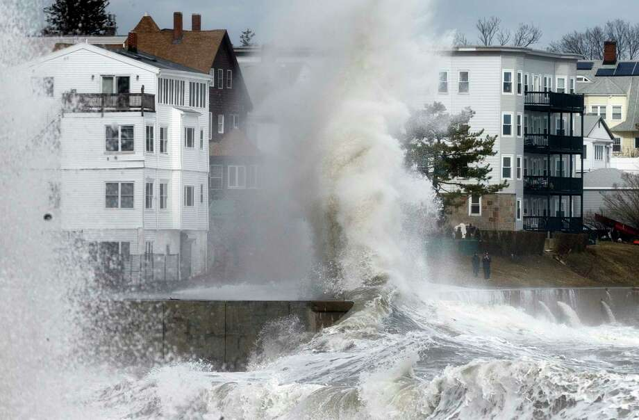 A large wave crashes into a seawall in Winthrop, Mass., Saturday, March 3, 2018, a day after a nor'easter pounded the Atlantic coast. Officials in eastern Massachusetts, where dozens of people were rescued from high waters overnight, warned of another round of flooding during high tides expected at midday. (AP Photo/Michael Dwyer) Photo: Michael Dwyer / Copyright 2018 The Associated Press. All rights reserved.