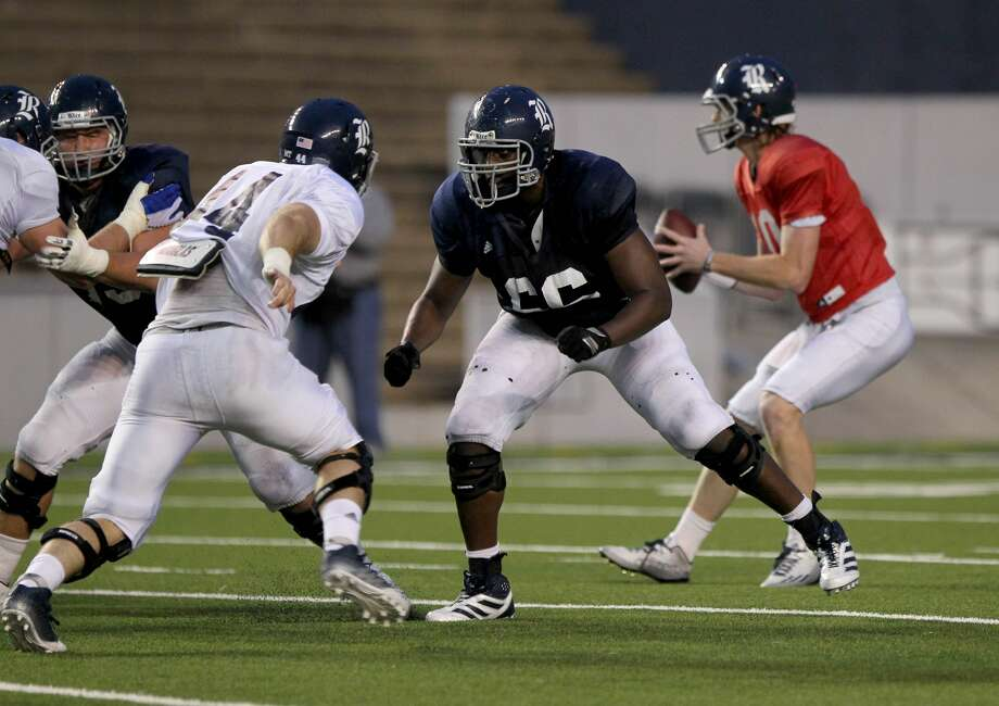 Calvin Anderson #66 pass blocks against Brian Womac #44 during the Rice University Blue Gray spring football game at Rice Stadium Friday, April 10, 2015, in Houston, Texas. ( Gary Coronado / Houston Chronicle ) Photo: Gary Coronado/Houston Chronicle