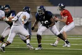Calvin Anderson #66 pass blocks against Brian Womac #44 during the Rice University Blue Gray spring football game at Rice Stadium Friday, April 10, 2015, in Houston, Texas. ( Gary Coronado / Houston Chronicle )