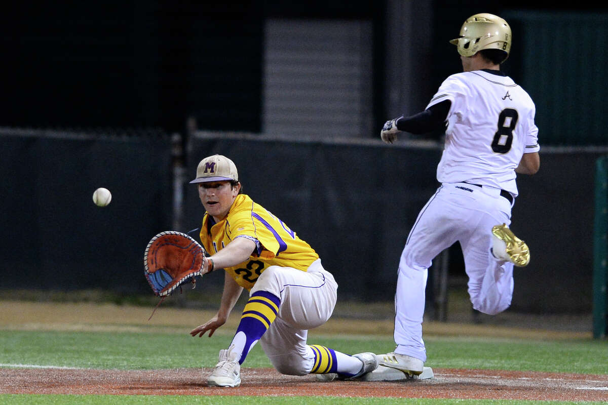 Midland High's Sam Matchus (22) attempts an out at first base against Andrews' Gustavo Rodriguez (8) in the Tournament of Champions March 3, 2018, at Christensen Stadium. James Durbin/Reporter-Telegram