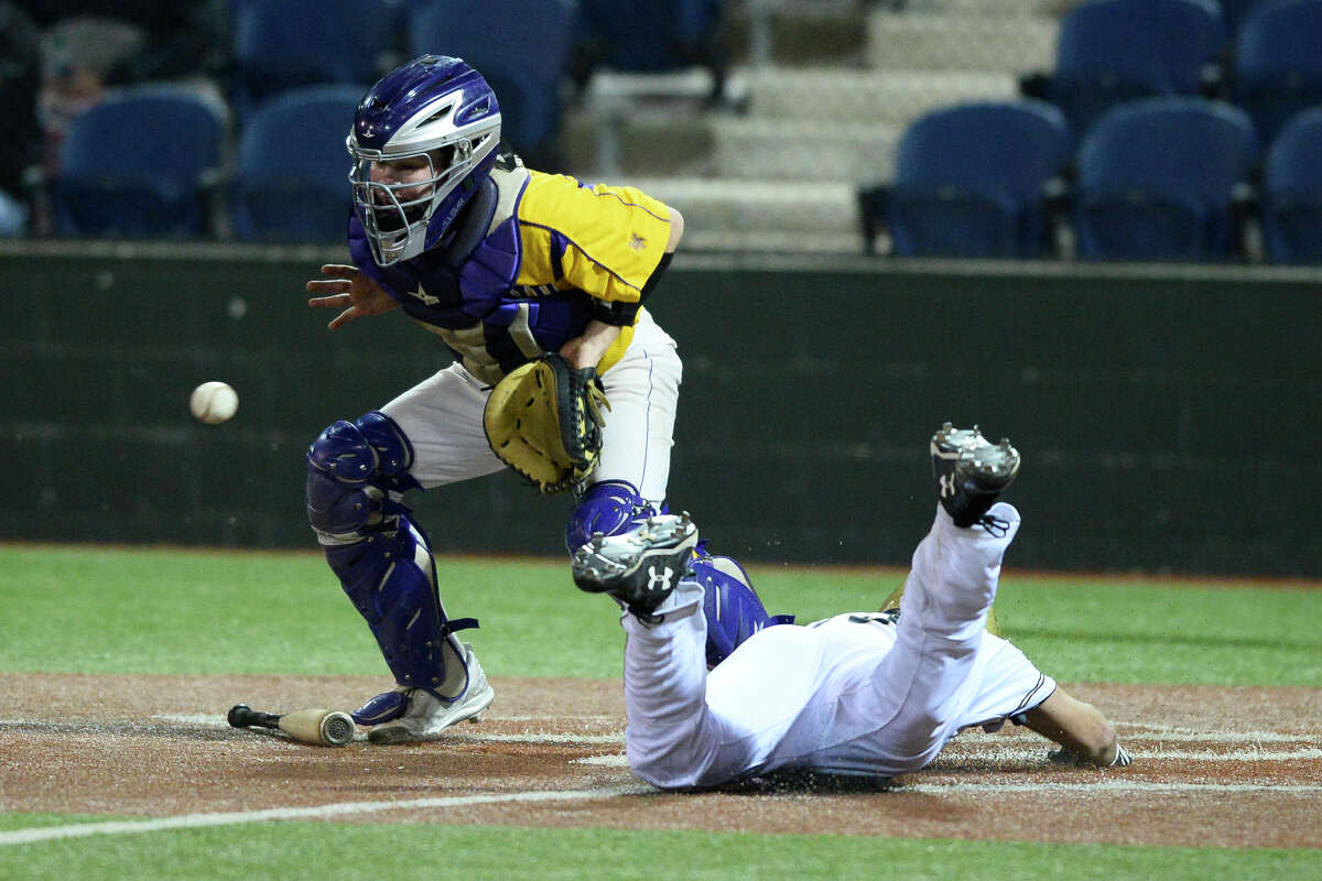 Midland High's Wyatt Tyler (6) attempts to get an out against Andrews' Matthew O'Connor (15) in the Tournament of Champions March 3, 2018, at Christensen Stadium. James Durbin/Reporter-Telegram