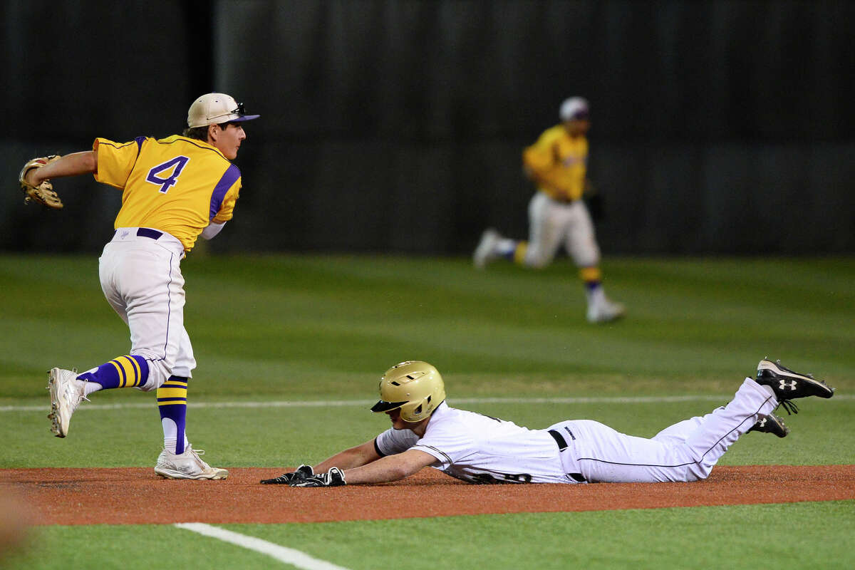 Midland High's Ivan Dominguez (4) turns a double play over Andrews' Gustavo Rodriguez (8) in the Tournament of Champions March 3, 2018, at Christensen Stadium. James Durbin/Reporter-Telegram