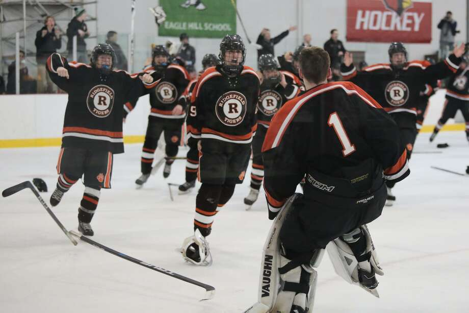 Ridgefield celebrates their 6-4 victory over Greenwich during the FCIAC Boys Ice Hockey Championship in Greenwich, Conn. on Saturday, March 3, 2018. Photo: Chris Palermo / For Hearst Connecticut Media / Stamford Advocate Freelance