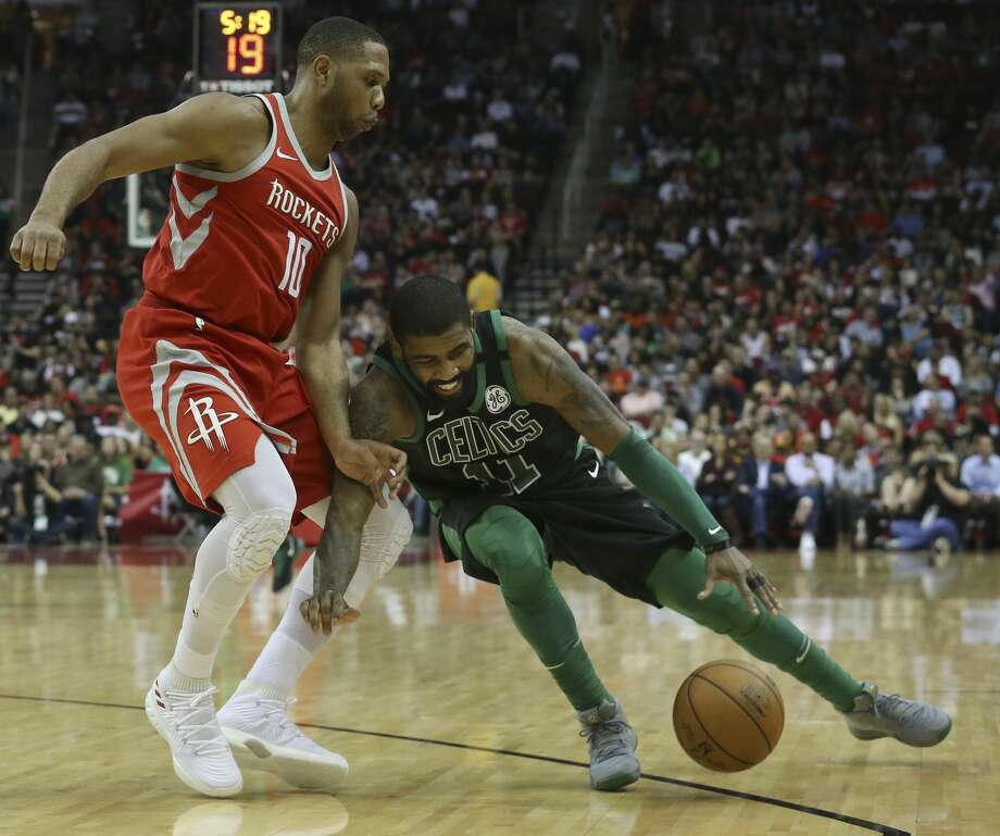 Boston Celtics guard Kyrie Irving (11) slips while Houston Rockets guard Eric Gordon (10) is defensing during the second quarter of a NBA game at the Toyota Center on Saturday, March 3, 2018, in Houston. ( Yi-Chin Lee / Houston Chronicle ) Photo: Yi-Chin Lee/Houston Chronicle