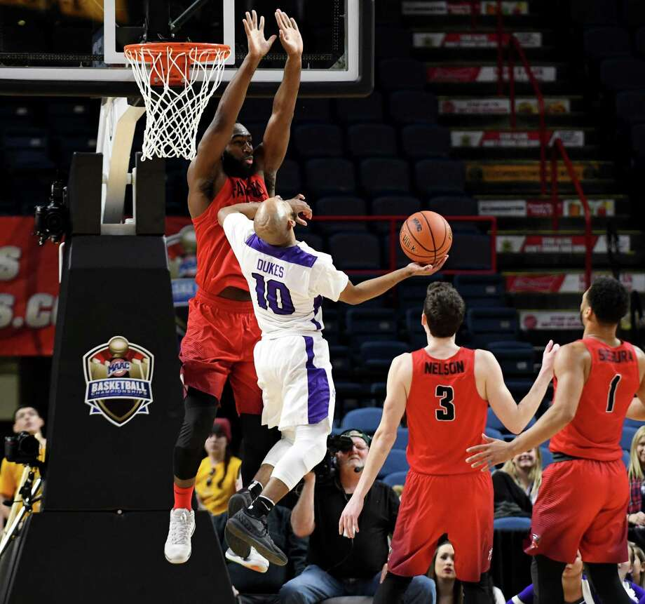 Niagara University guard Kahlili Dukes' shot is denied by Jonathan Kasibabu from Fairfield University during MAAC championship basketball quarterfinals on Saturday, March 3, 2018, at the Times Union Center in Albany, N.Y. (Will Waldron/Times Union) Photo: Will Waldron / Albany Times Union / 20043100A