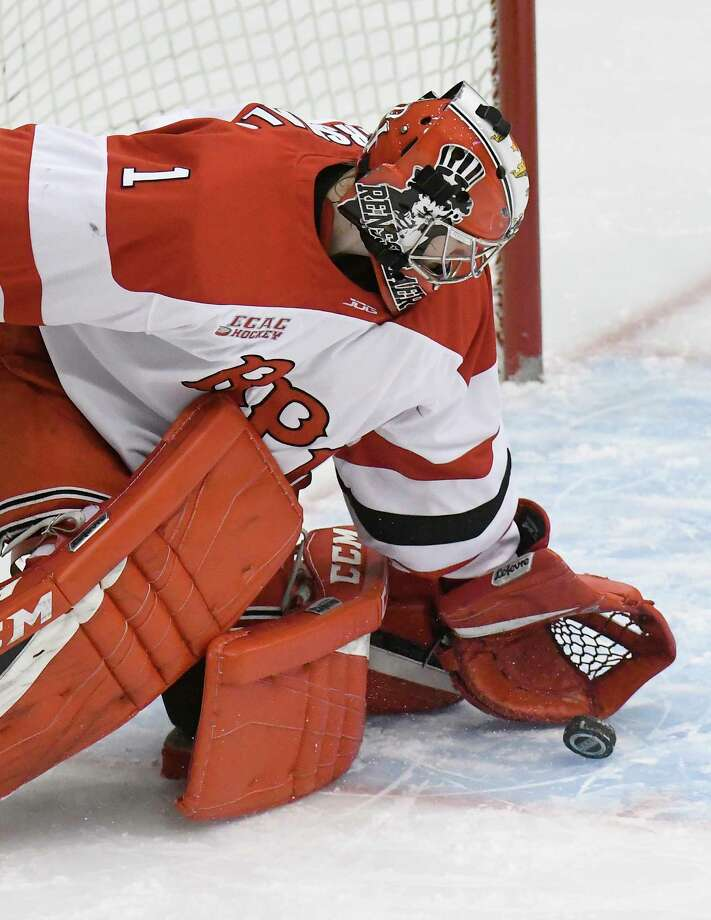 Rensselaer Polytechnic Institute's goaltender Linden Marshall (1) makes a save against Maine during the first period of an NCAA college hockey game Friday, Dec. 29, 2017, in Troy, N.Y., (Hans Pennink / Special to the Times Union) Photo: Hans Pennink / Hans Pennink