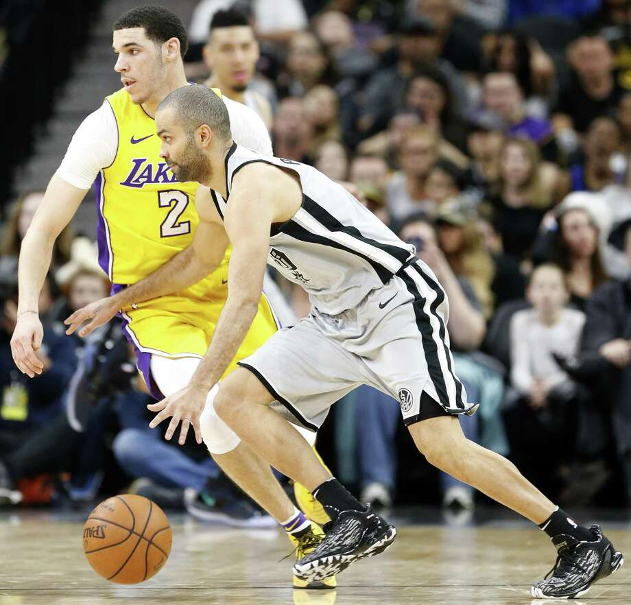 Spurs guard Tony Parker, foreground, tries to dribble around his Los Angeles Lakers counterpart, Lonzo Ball, during second half action on March 3 at the AT&T Center. A reader says she was disappointed in Spurs fans during the game. Photo: Edward A. Ornelas /San Antonio Express-News / © 2018 San Antonio Express-News