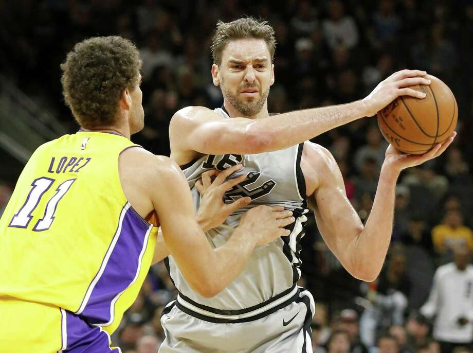 San Antonio Spurs center Pau Gasol (16) looks to pass around Los Angeles Lakers center Brook Lopez (11) during first half action Saturday March. 3, 2018 at the AT&T Center. Photo: Edward A. Ornelas, Staff / San Antonio Express-News / © 2018 San Antonio Express-News