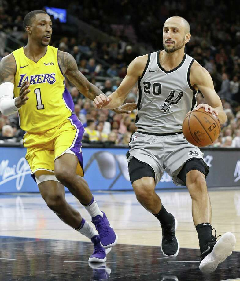 San Antonio Spurs guard Manu Ginobili (20) looks for room around Los Angeles Lakers guard Kentavious Caldwell-Pope (1) during first half action Saturday March. 3, 2018 at the AT&T Center. Photo: Edward A. Ornelas, Staff / San Antonio Express-News / © 2018 San Antonio Express-News