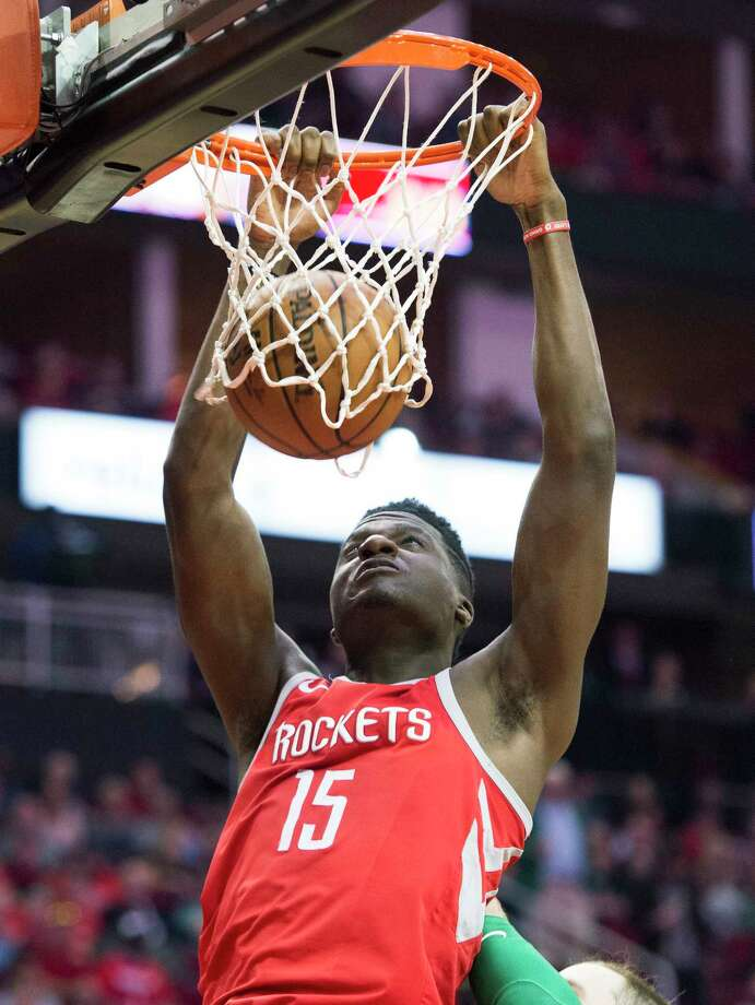 Houston Rockets center Clint Capela dunks against the Boston Celtics during the first half of an NBA basketball game Saturday, March 3, 2018, in Houston. (AP Photo/George Bridges) Photo: George Bridges / FR171217 AP