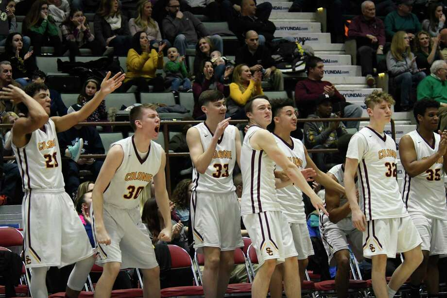 Colonie basketball players cheer following a two-pointer during the Class AA Section II title game against Shen on Saturday, Mar. 3, 2018, at Cool Insuring Arena in Glens Falls, N.Y. Colonie fell to Shen 43-40 for the Class AA title. (Jenn March, Special to the Times Union) Photo: Jenn March / © Jenn March 2018 © Albany Times Union 2018
