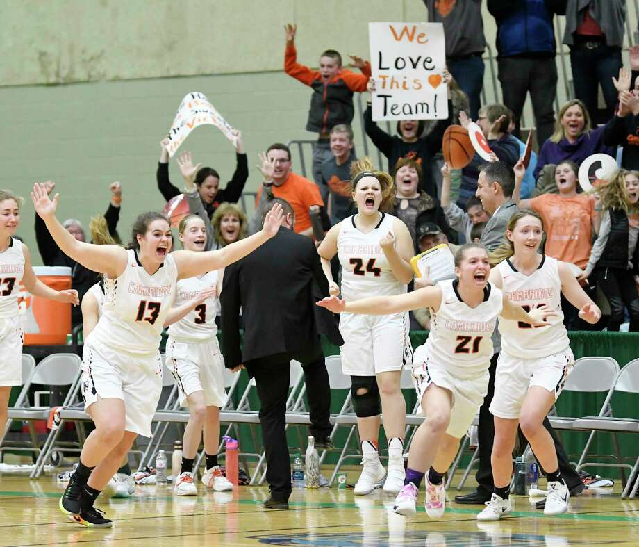 Cambridge players celebrate a 62-59 win against Mekeel Christian Academy's during overtime of a girls Section II Class C high school final basketball game Saturday, March 3, 2018, in Troy, N.Y. (Hans Pennink / Special to the Times Union) Photo: Hans Pennink / Hans Pennink