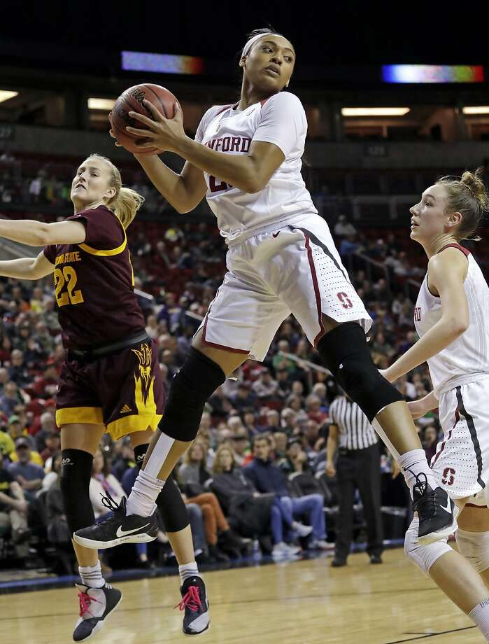 Stanford's Dijonai Carrington grabs a rebound in front of Arizona State's Courtney Ekmark (22) during the first half of an NCAA college basketball game in the semifinals of the Pac-12 women's tournament Saturday, March 3, 2018, in Seattle. (AP Photo/Elaine Thompson) Photo: Elaine Thompson, Associated Press