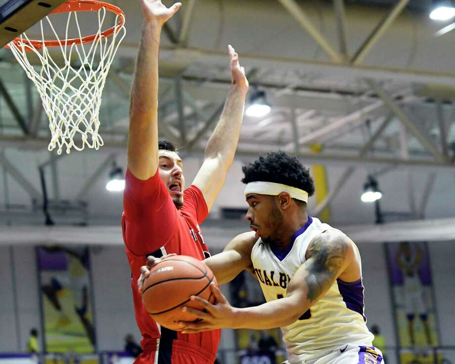 Stony Brook Seawolves forward Jakub Petras (32) defends against UAlbany's guard David Nichols (13) during the first half of an NCAA college basketball quarterfinal game in the America East Conference tournament, Saturday, March 3, 2018, in Albany, N.Y. (Hans Pennink / Special to the Times Union) Photo: Hans Pennink / Hans Pennink