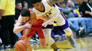 Stony Brook Seawolves guard Jordan McKenzie (10) fouls UAlbanymguard David Nichols (13) during the second half of an NCAA college basketball quarterfinal game in the America East Conference tournament, Saturday, March 3, 2018, in Albany, N.Y. (Hans Pennink / Special to the Times Union)