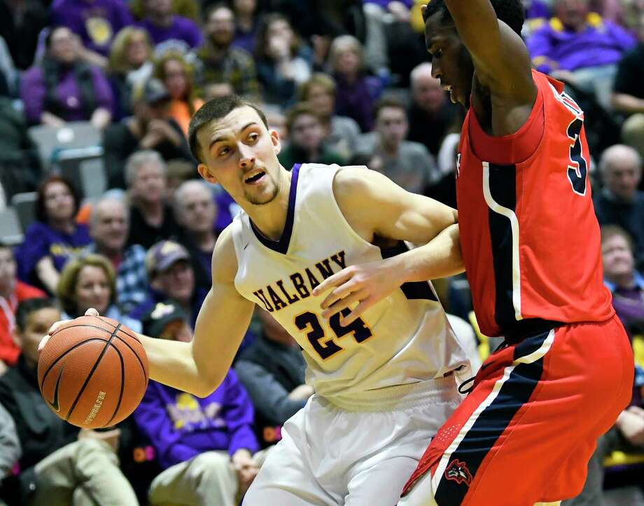 UAlbany guard Joe Cremo (24) moves the ball against Stony Brook Seawolves forward Elijah Olaniyi (3) during the first half of an NCAA college basketball quarterfinal game in the America East Conference tournament, Saturday, March 3, 2018, in Albany, N.Y. (Hans Pennink / Special to the Times Union) Photo: Hans Pennink / Hans Pennink