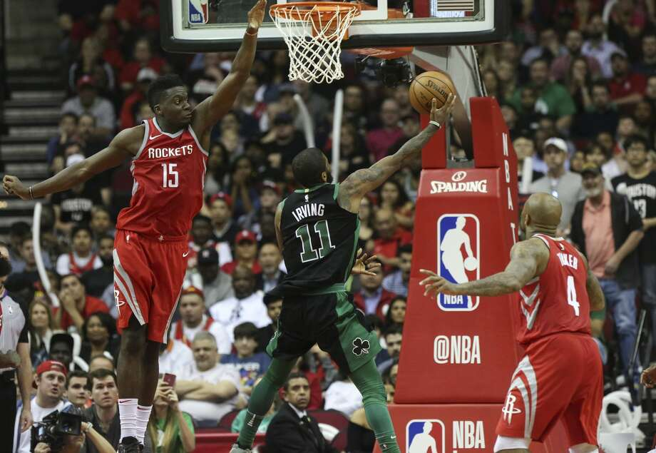Boston Celtics guard Kyrie Irving (11) goes to the basket while Houston Rockets center Clint Capela (15) is tring to stop him during the fourth quarter of a NBA game at the Toyota Center on Saturday, March 3, 2018, in Houston. The Houston Rockets defeated the against the Boston Celtics 123-120. ( Yi-Chin Lee / Houston Chronicle ) Photo: Yi-Chin Lee/Houston Chronicle