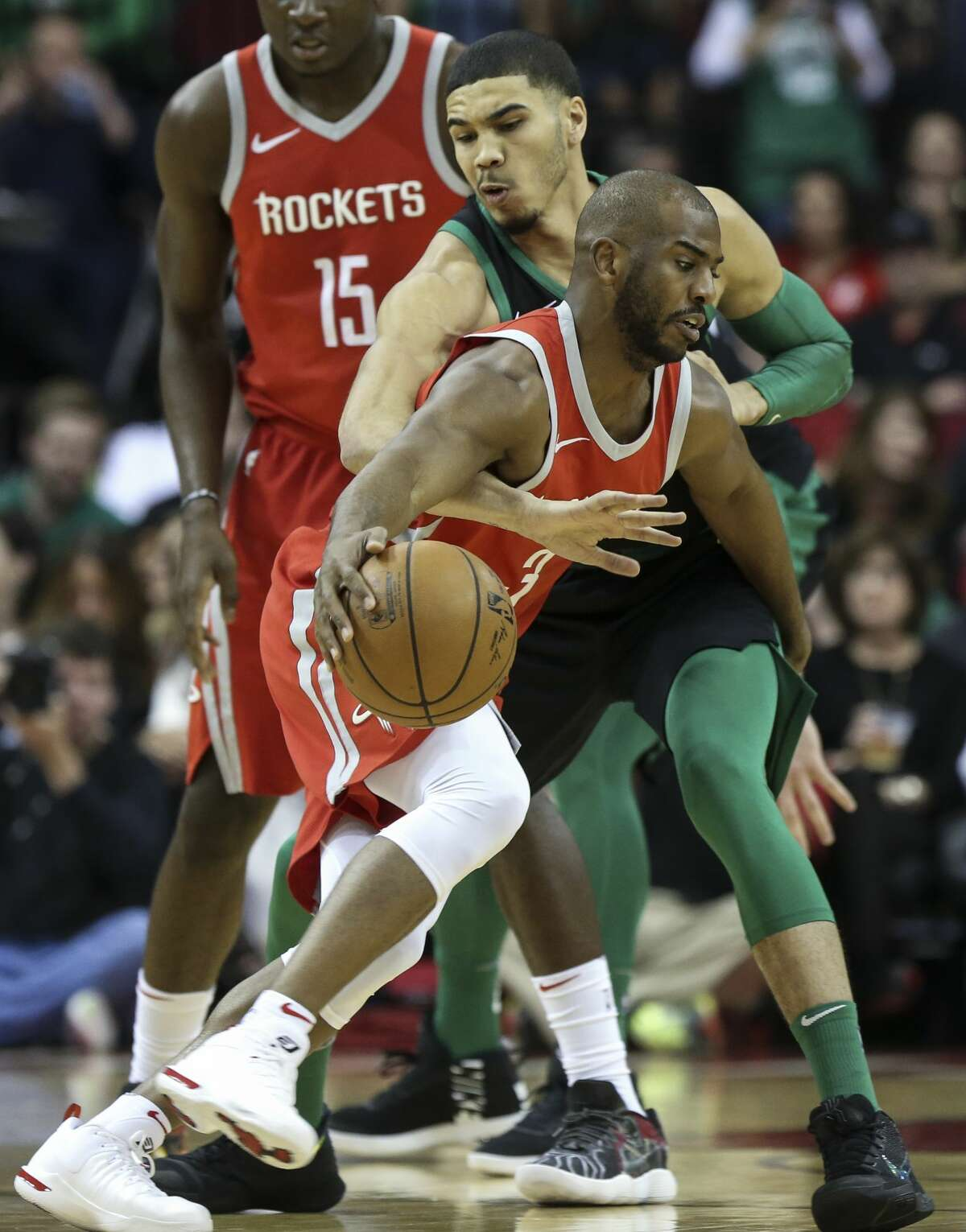 Boston Celtics forward Jayson Tatum (0) tries to strip the ball away from Houston Rockets guard Chris Paul (3) during the first quarter of a NBA game at the Toyota Center on Saturday, March 3, 2018, in Houston. ( Yi-Chin Lee / Houston Chronicle )
