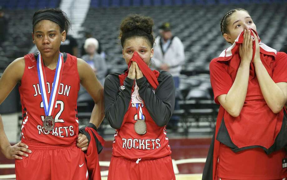 Rocket players (from left) Desiree Lewis, Corina Carter and Kyra White stare in disbelief after giving up a large second have lead to lose the game as Judson plays Plano in the Class 6A high school girls state championship game at the Alamodome on March 3, 2018. Photo: Tom Reel, Staff / San Antonio Express-News / 2017 SAN ANTONIO EXPRESS-NEWS