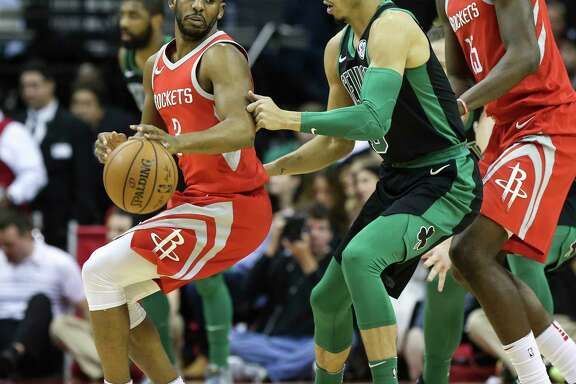 Houston Rockets guard Chris Paul (3) tries to past Boston Celtics forward Jayson Tatum (0) during the first quarter of a NBA game at the Toyota Center on Saturday, March 3, 2018, in Houston. ( Yi-Chin Lee / Houston Chronicle )