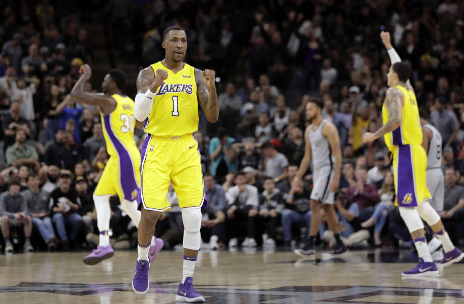 Los Angeles Lakers guard Kentavious Caldwell-Pope (1) celebrates a late score against the San Antonio Spurs during the second half of an NBA basketball game, Saturday, March 3, 2018, in San Antonio. Los Angeles won 116-112.(AP Photo/Eric Gay)