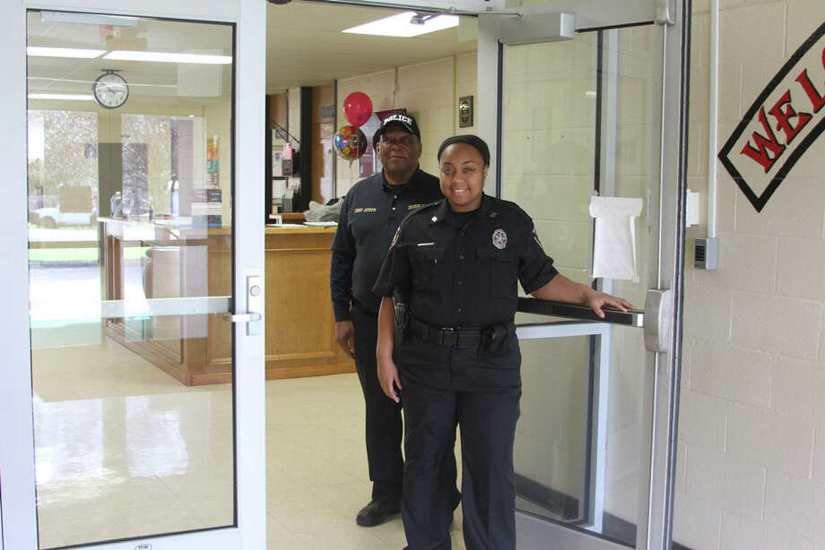 COCISD Police Officer Tamesha Davison, pictured with COCISD Police Chief Roosevelt Joseph, monitors the front entrance and nearby camera monitors at Lincoln Junior High, as part of the increased security measures that have been taken by the district. Photo: Submitted