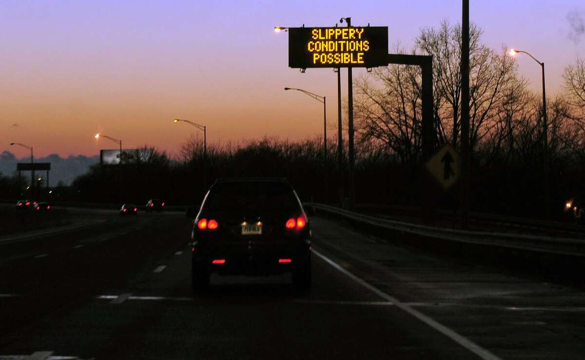 A highway sign warns drivers of slippery conditions along I-95 southbound in Stratford, Conn., in this file photo.