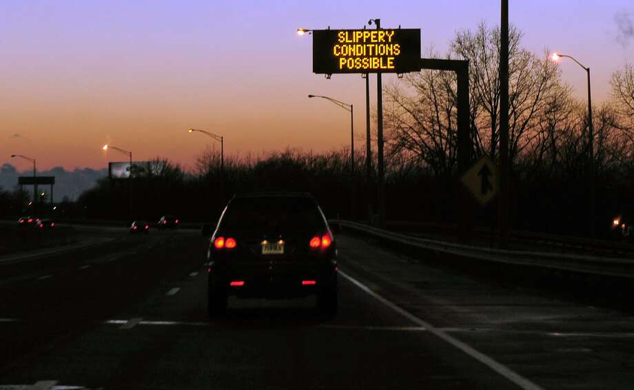 A highway sign warns drivers of slippery conditions along I-95 southbound in Stratford, Conn., in this file photo. Photo: Christian Abraham / Christian Abraham / Connecticut Post