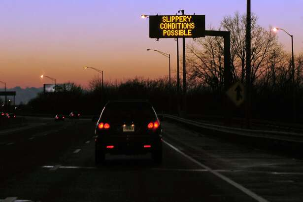 A highway sign warns drivers of slippery conditions along I95 southbound in Stratford, Conn. on Tuesday December 10, 2013.