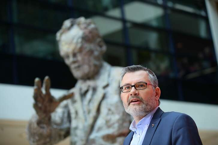 Dietmar Nietan, treasurer of Germany's Social Democrats (SPD) party, stands in front of a statue of former SPD leader Willy Brandt as he announces the results of the SPD party members' referendum on whether or not to join a new coalition government with German Chancellor Angela Merkel's conservatives, on March 4, 2018 at the SPD headquarters in Berlin. The members of Germany's second biggest party have in their high-stakes referendum approved a plan to join Chancellor Angela Merkel's coalition. The make or break vote was the last hurdle in the way of Merkel's fourth term in office and essentially ends a political stalemate that has plagued the country since September's inconclusive elections. / AFP PHOTO / DPA / Michael Kappeler / Germany OUTMICHAEL KAPPELER/AFP/Getty Images