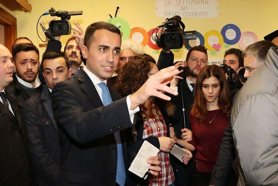 Luigi Di Maio, leader of Italy's populist Five Star Movement, arrives to vote at a polling station in Naples. Photo: CARLO HERMANN, AFP/Getty Images