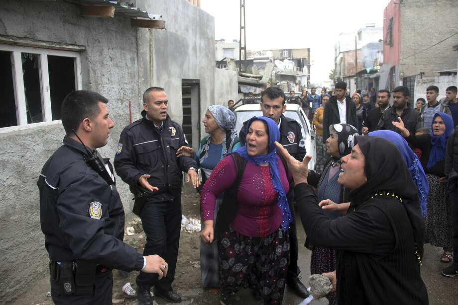 Residents in Adana, Turkey, try last month to at tack the house of a man suspected of raping a girl. Photo: Associated Press