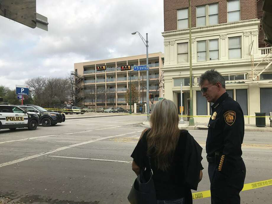 San Antonio police investigate the death of a woman found downtown across from a residential complex Sunday morning, March 4, 2018. Photo: Nicole Bautista