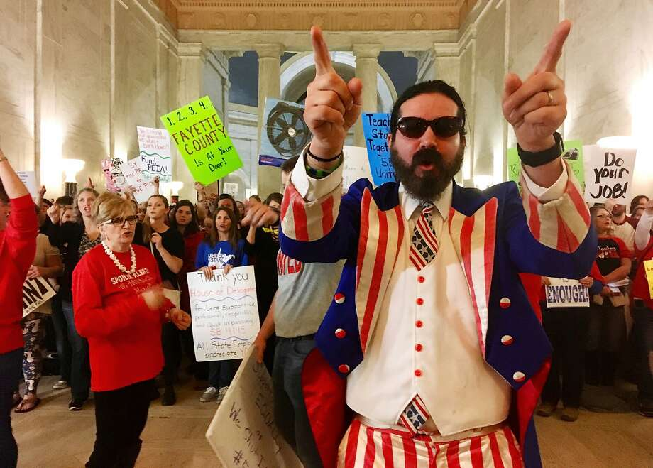 Parry Casto, a fifth-grade teacher from Huntington, W.Va., dresses as Uncle Sam during a rally Thursday at the state Capitol in Charleston. Teachers are seeking a 5 percent pay increase. Photo: John Raby, Associated Press