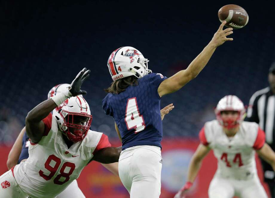 Katy Tigers Moro Ojomo (98) pressures Atascocita Eagles quarterback Jack Roe (4) in the first half during the high school football playoff game between the Atascocita Eagles and the Katy Tigers at NRG Stadium in Houston, TX on Saturday, December 1, 2017. Photo: Tim Warner, Freelance / Houston Chronicle