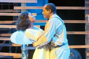 "From left:�Jemier Jenkins as Blanche Dubois and Fred Pitt as Mitch in African-American Shakespeare Company's ""A Streetcar Named Desire."""