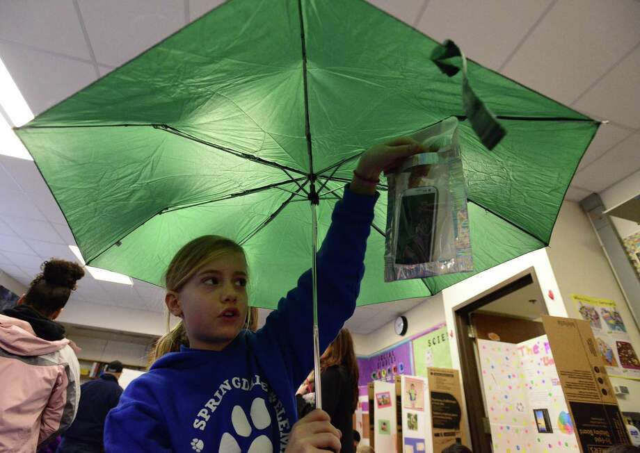 Ludivine Jacquet, a fifth-grader at Springdale School, demonstrates her Brella-Pocket invention during the school's Invention Convention on Friday, March 2, 2018 in Stamford, Connecticut. Photo: Matthew Brown / Hearst Connecticut Media / Stamford Advocate