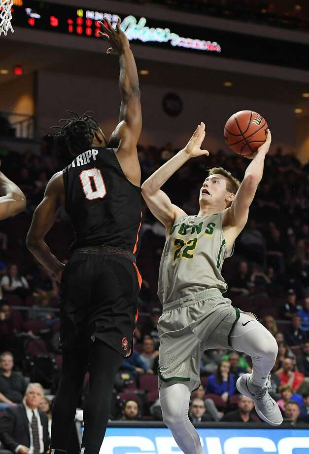 LAS VEGAS, NV - MARCH 03:  Chase Foster #22 of the San Francisco Dons drives to the basket against Jahlil Tripp #0 of the Pacific Tigers during a quarterfinal game of the West Coast Conference Basketball Tournament at the Orleans Arena on March 3, 2018 in Las Vegas, Nevada. The Dons won 71-70.  (Photo by Ethan Miller/Getty Images) Photo: Ethan Miller, Getty Images