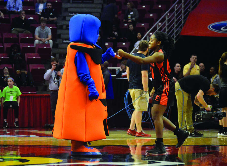 EHS sophomore Quierra Love bumps fists with Add A. Tude at the state tournament.