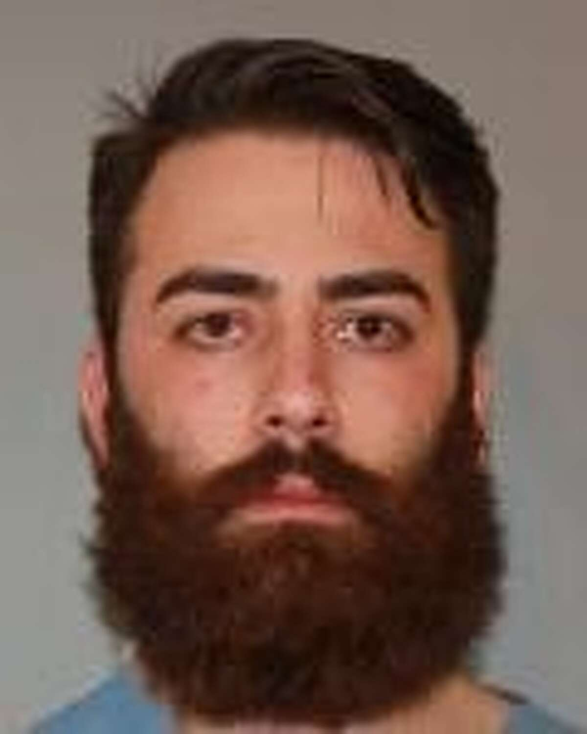 Christopher Neumann, 26, was charged with vehicular assault, a felony, and DWI after police allege he crashed into two state troopers and a tow truck driver at Exit 8 of I-90 March 4, 2018. (State Police)