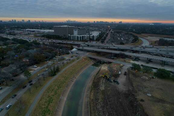 An excavator works on an area along Brays Bayou just outside the 610 Loop in the Meyerland area, Thursday, Jan. 18, 2018, in Houston.