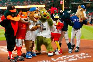 HOUSTON, TX - MAY 28: (L-R) The Oriole Bird, Diesel, Clark, Orbit,Fredbird, Toro and Rangers Captain celebrates Orbit's birthday  at Minute Maid Park on May 28, 2017 in Houston, Texas.  (Photo by Bob Levey/Getty Images)