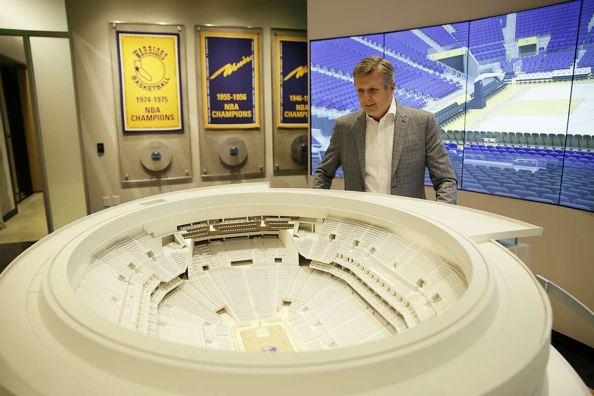 In this photo taken Jan. 24, 2018, Golden State Warriors President and COO Rick Welts looks over a model of Chase Center at the Chase Center Experience in San Francisco.