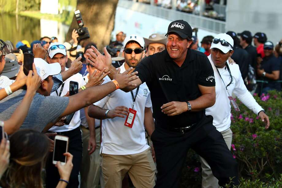 MEXICO CITY, MEXICO - MARCH 04:  Phil Mickelson greets fans after winning the final round of World Golf Championships-Mexico Championship on a playoff hole against Justin Thomas (not in frame) at Club De Golf Chapultepec on March 4, 2018 in Mexico City, Mexico. (Photo by Gregory Shamus/Getty Images) Photo: Gregory Shamus, Getty Images