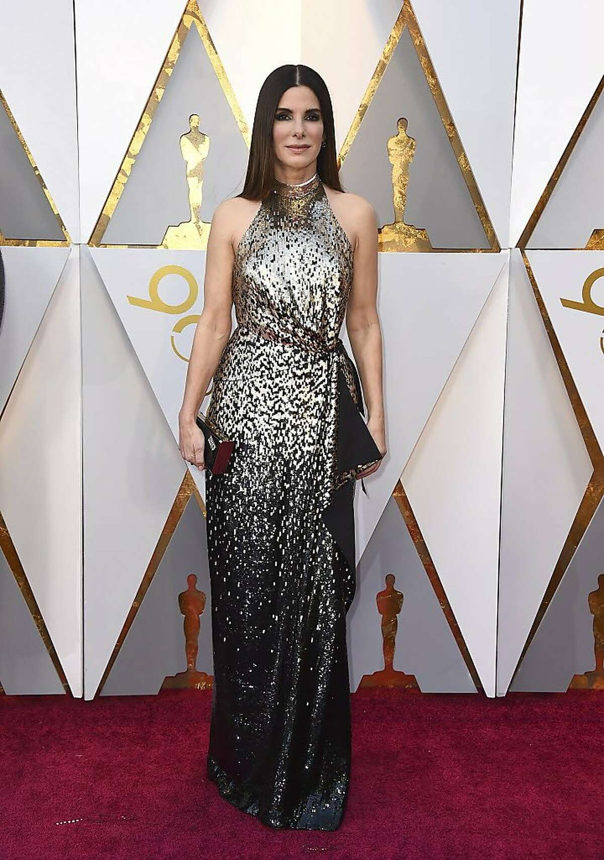 Sandra Bullock arrives at the Oscars on Sunday, March 4, 2018, at the Dolby Theatre in Los Angeles. (Photo by Jordan Strauss/Invision/AP)