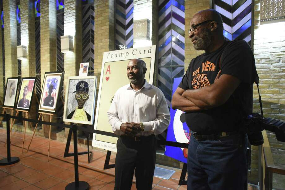 Artists Raashad Ali, left, and Mark Barnes attend an opening of their show at Antioch Missionary Baptist Church on Feb. 28, 2018. Photo: Billy Calzada, Staff / San Antonio Express-News / San Antonio Express-News